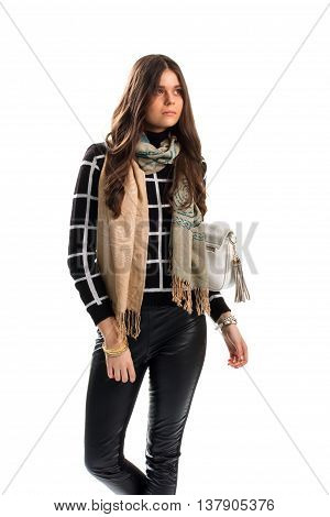 Lady wears beige scarf. Black and white checkered pullover. Trend of this autumn. Stylish scarf with print.