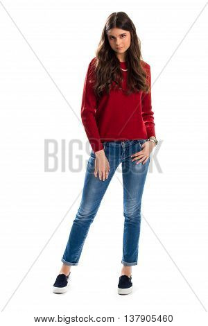 Woman wears red sweater. Jeans and slip on shoes. Autumn outfit with denim pants. Garments from lookbook.