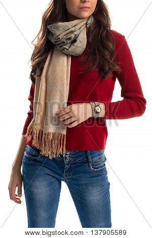 Lady in red sweater. Beige scarf with pattern. Slim fit jeans. Accessories from new lookbook.