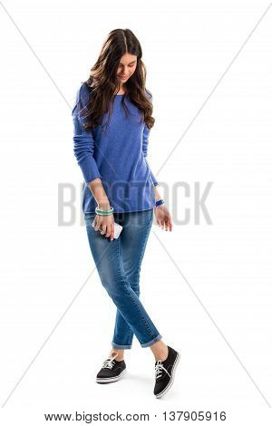 Woman in blue sweatshirt. Young lady holds phone. Modern fashion model. Nice clothes and new gadget.