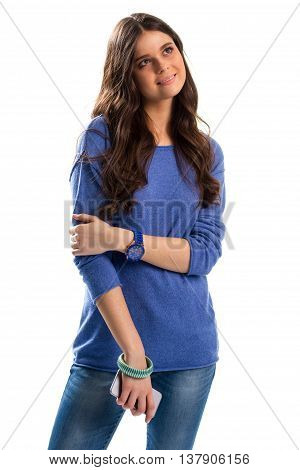 Smiling woman looks up. Cell phone and watch. Dreaming girl on white background. Sports watch and casual apparel.