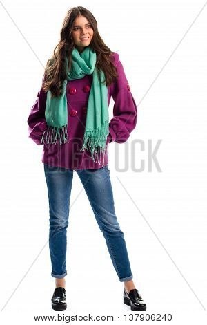 Woman in purple coat smiling. Jeans and black glossy shoes. Spring outfit with colorful scarf. Fleece garment of high quality.