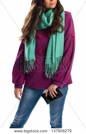 Lady in short purple coat. Wallet and scarf with fringe. Accessory from limited collection. Spring scarf of bright color.