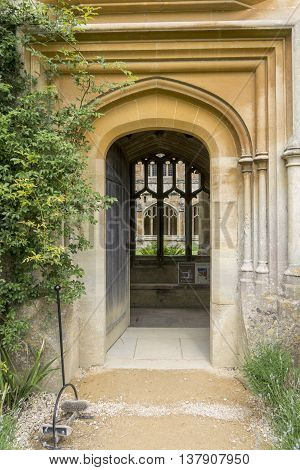 LACOCK ABBEY, LACOCK, WILTSHIRE, UK, JUNE 2016 - Open medieval door into the cloisters at Lacock Abbey Lacock Wiltshire UK