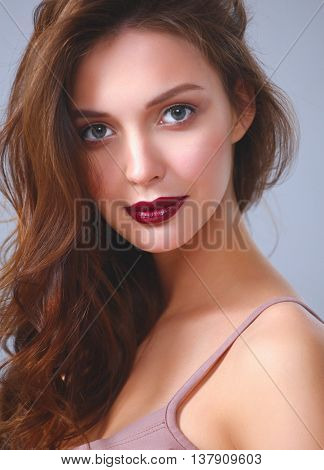 Portrait of beautiful young woman . Isolated on white background