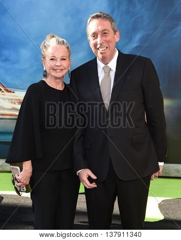 LOS ANGELES - JUL 9:  Ivan Reitman & Genevieve Robert arrives to the