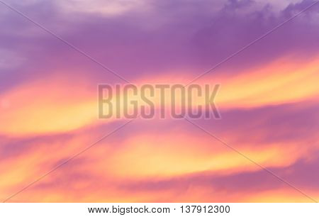 Intense colorful sunset cloud formations brightly lit as night falls.