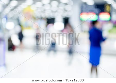 Blur Background : Passenger Airplane Waiting For Bag At Baggage Claim With Bokeh Light
