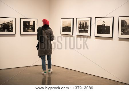 NEW YORK CITY - FEBRUARY 27: Woman standing in the photo gallery on February 27 2016 New York City USA