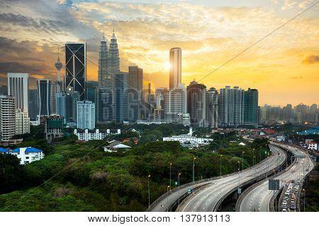 Kuala lumpur skyline in the evening Kuala lumpur Malaysia skyline with sunset.