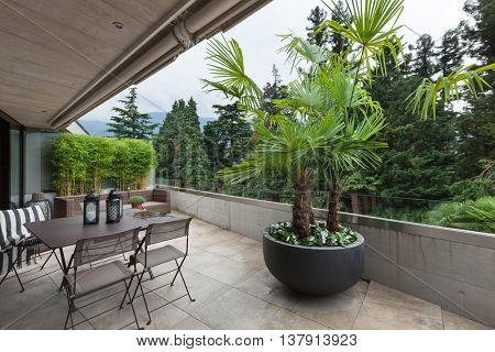 View of a modern balcony with garden furniture