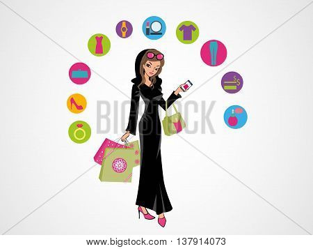 Arab Woman Shopping Online. Glamorous Arab girl standing in her traditional Arabic dress holding shopping bags and her hand bag. On-line shopping in Arab world.