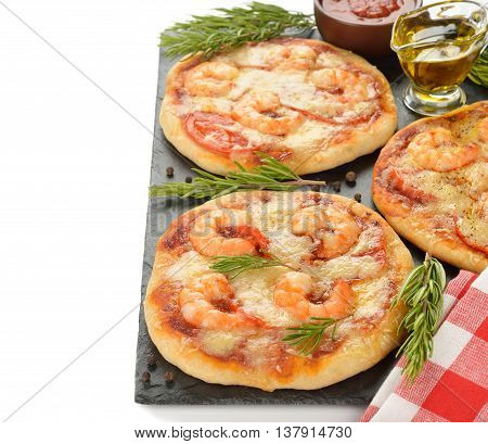 Mini pizza with shrimp and rosemary on a white background