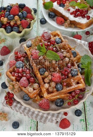 Waffles with berries on a white background