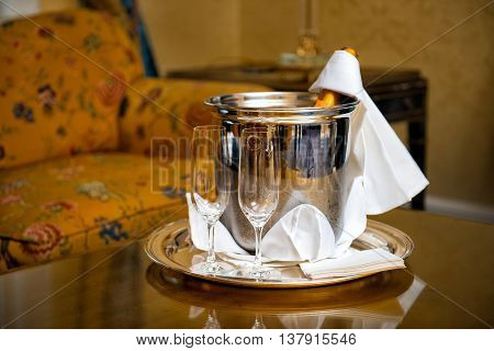 Luxury hotel room service with Champagne bottle and galasses
