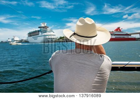 A senior man going back to cruise ship after island tour