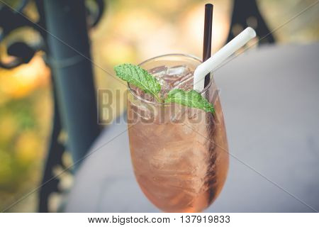 A glass of lemonade iced. The Juice soda in afternoon. Tasty cool beverage with lemonade.(selective focus)