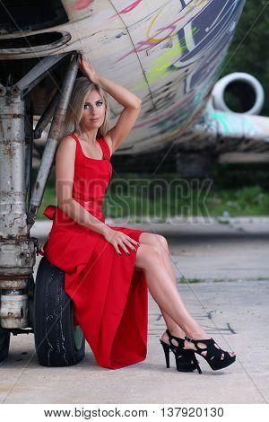 beautiful  woman and old aircraft