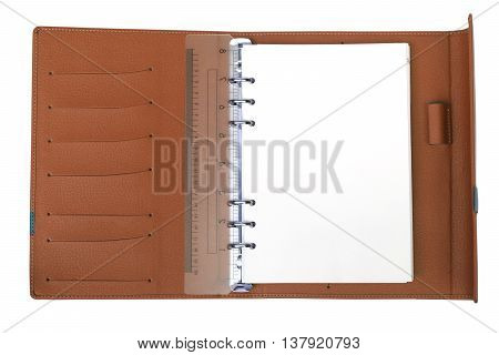 A Brown notebook with white blank page