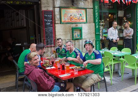 Lyon, France - June 16, 2016: Northern Ireland fans sitting at in a restaurant in Lyon at the European Football Championship EURO 2016