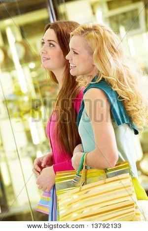Two young beautiful women shopping together