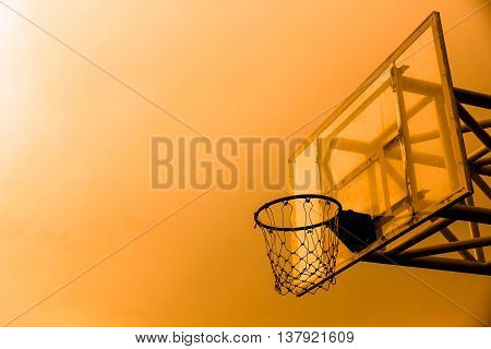 Basketball hoop silhouette. Basketball hoop with sunset silhouette background