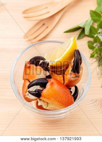 Fresh Steamed Red Crabs Leg In Glass Bowl . Red Crabs Leg With Ingredients. Steamed Red Crabs Leg Wi