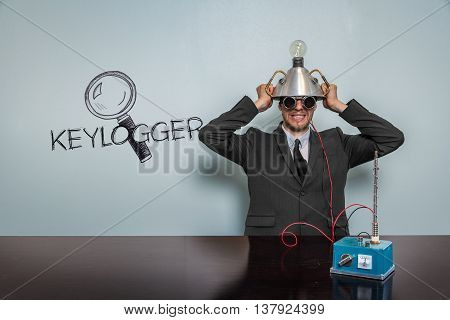 Keylogger text with vintage businessman and machine at office