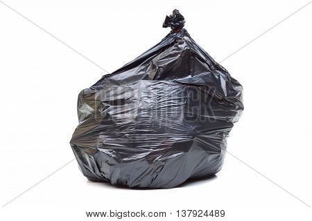 Black plastic garbage bag isolated on whie