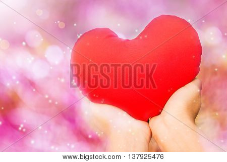 Hand And Red Heart In Dreamy Sweet And Romantic Pink Bokeh