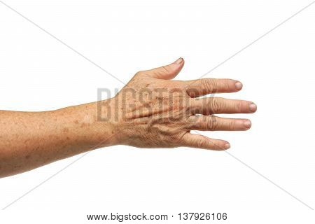 an old female hand full of freckles