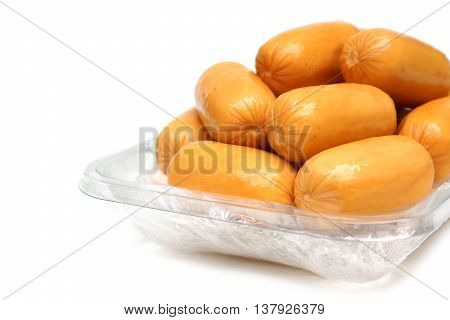 Hot dogs on plastic container isolated on white