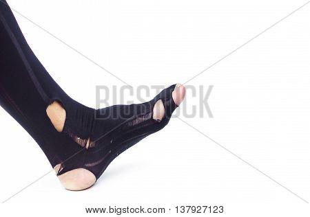 A business man wearing a torn sock