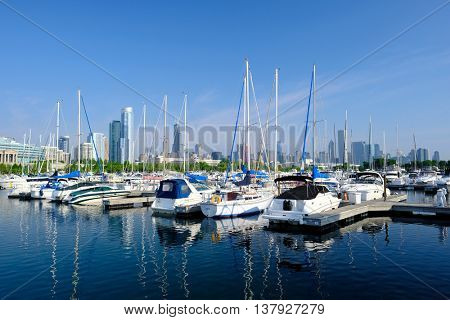 Chicago skyline in the morning with urban marina in front. No brand names or copyright objects.