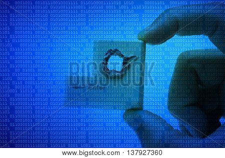 Hacker's hand picking up computer enter button with a hole representing computer security breach isolated