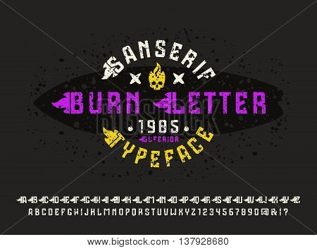 Sanserif font with flame initial letter and spray texture. Typeface design for t-shirt. Color print on black background