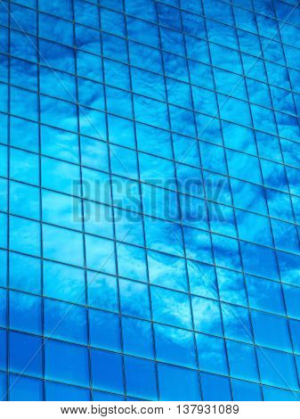 Background Clouds Reflected In The Windows Of A Modern Building On The Sunset At The End Of The Day