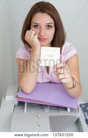 Businesswoman With Copier Thinking On The White Background