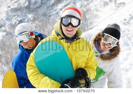 Portrait of three happy friends in googles