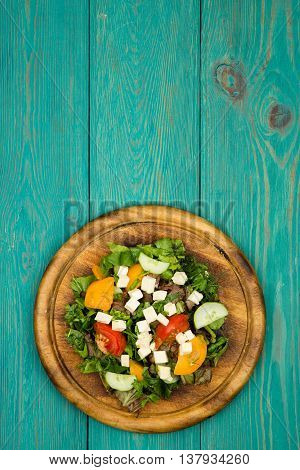 Fresh Vegetable Salad With Greenery, Cheese, Tomatoes, Cucumber On A Blue Wooden Table