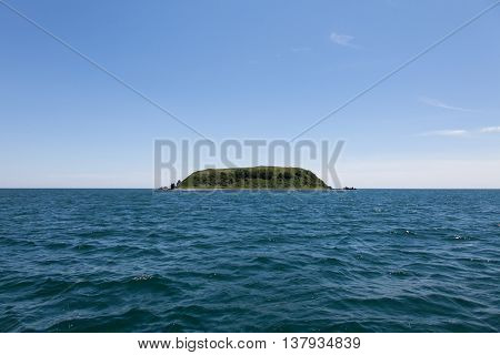 Single island in Sea of Japan. Desert island.