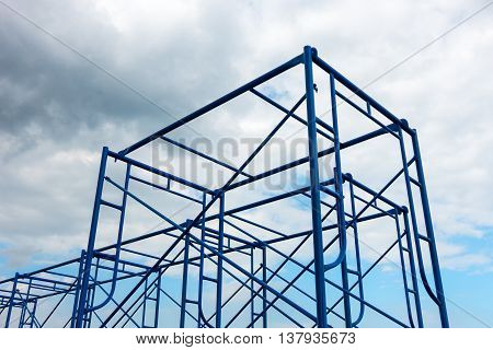 Scaffolding site erection on cloudy background, Steel frame.