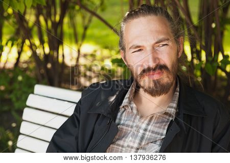 Outdoor Portrait Of Young Bearded Asian Man