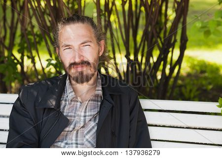 Young Bearded Asian Man In Summer Park