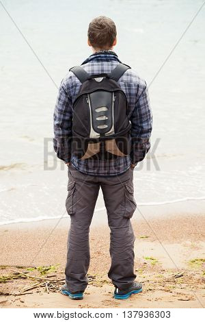 Traveler On Sea Coast. Young Adult  Man
