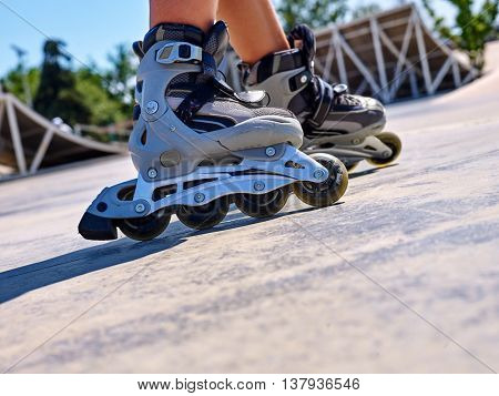 Roller skate close up in skatepark. Low section of children.