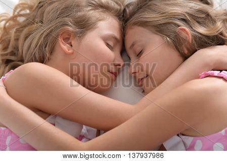 Portrait of a cute little girls sleeping in bed