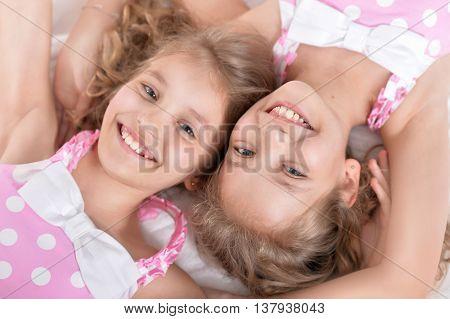 Portrait of a cute little girls in bed