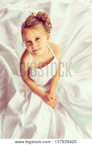 Pretty little girl wearing wedding dress