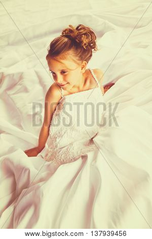 Beautiful young child bride in wedding dress